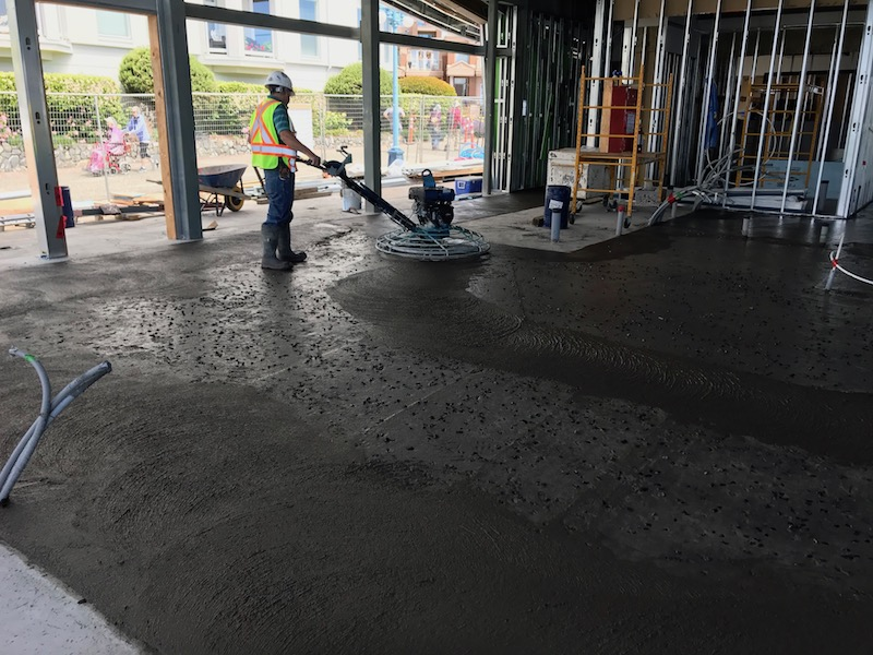 power troweling seeded concrete slab