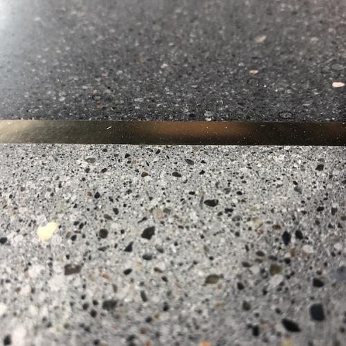 closeup brass strip with terrazzo