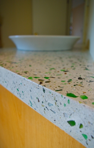 green and clear glass in terrazzo vanity